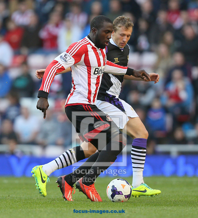 Picture by Paul Gaythorpe/Focus Images Ltd +447771 871632<br /> 29/09/2013<br /> Jozy Altidore of Sunderland and Leiva Lucas of Liverpool during the Barclays Premier League match at the Stadium Of Light, Sunderland.