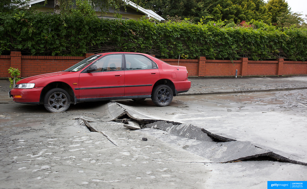 Road damage after a Powerful earth quake ripped through Christchurch, New Zealand on Tuesday lunch time killing at least 65 people as it brought down buildings, buckled roads and damaged churches and the Cities Cathedral. Photo Tim Clayton