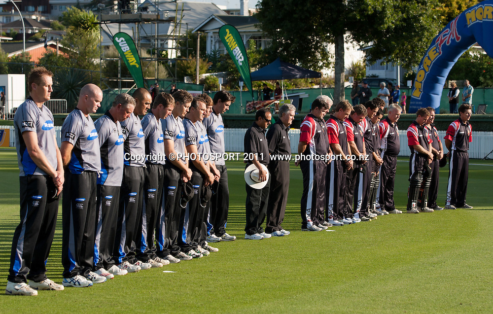 The teams observe a minute's silence in recognition of the Christchurch earthquake tragedy before the Titans International Twenty20 Cricket, Samsung NZCPA Masters XI v Australia, Seddon Park, Hamilton, New Zealand, Thursday 24 February 2011. Photo: Stephen Barker/PHOTOSPORT