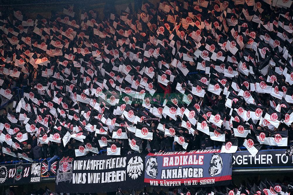 Eintracht Frankfurt fans in the stands wave flags
