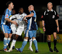 Photo: Richard Lane.<br />Wycombe Wanderers v Chelsea. Carling Cup, Semi Final 1st Leg. 10/01/2007. <br />Chelsea's Claude Makelele and Wycombe's Tommy Mooney square up after a challenge.