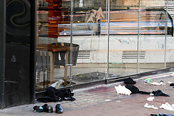 © Licensed to London News Pictures. 17/02/2019. London, UK. Personal belongings and blood smeared on the window of a shop, at the scene on Oxford Street in central London where three people were stabbed last night. The incident took place near Tape Nightclub. Photo credit: Ben Cawthra/LNP