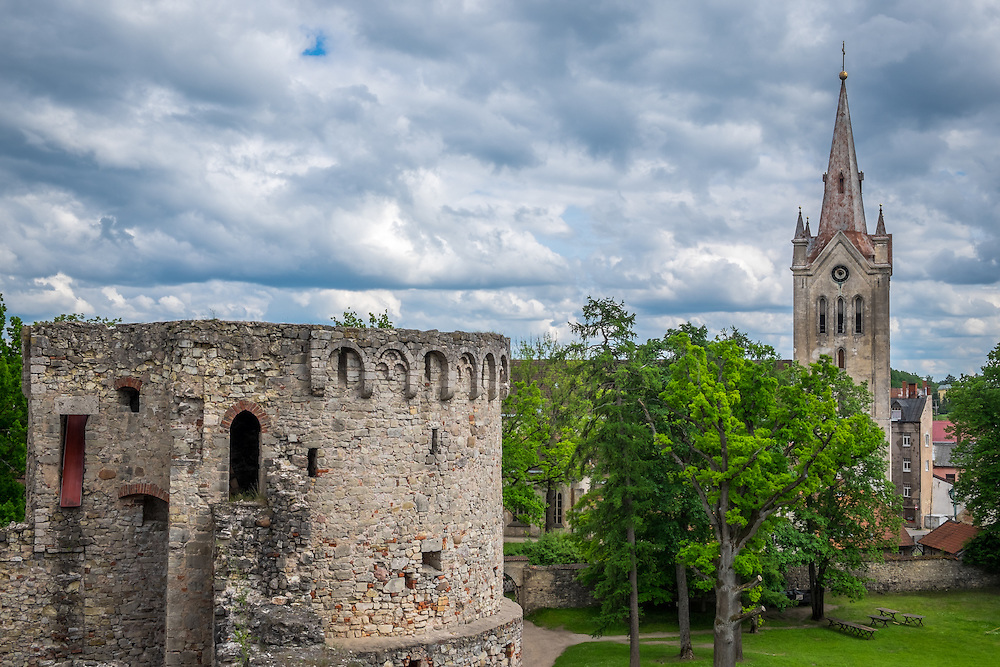 LATVIA, CESIS - CIRCA JUNE 2014: View of tower of the Cesis Castle, (Wenden) and  the St. John's Church in Latvia.
