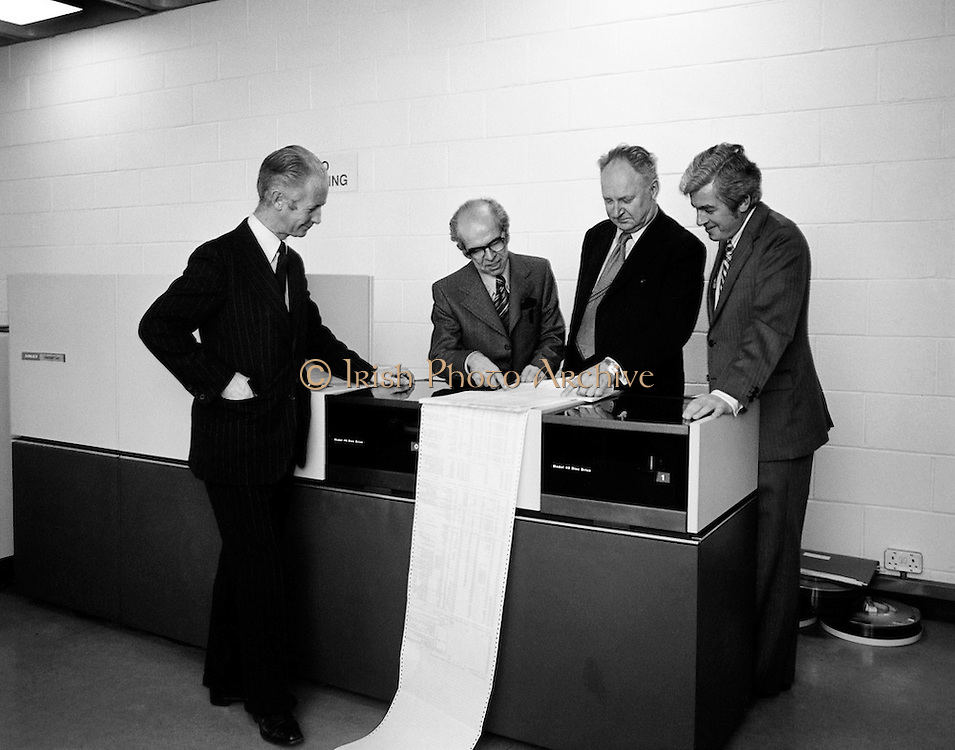 A Singer System 10 computer is installed in the Faculty of Commerce in University College Dublin, (U.C.D.). The computer would be used by graduate and post graduate students at the university. Pictured at the official handover were, (l-r): Professor M.J. McCormac, Dean, Faculty of Commerce, Professor Denis McConalogue, Professor of Computer Science; Dr Thomas Murphy, President, U.C.D. and Mr Michael McMahon, Regional Director for Ireland, Singer Business machines.<br /> 29/10/1975