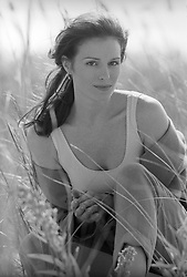 portrait of a woman sitting in tall beach grass