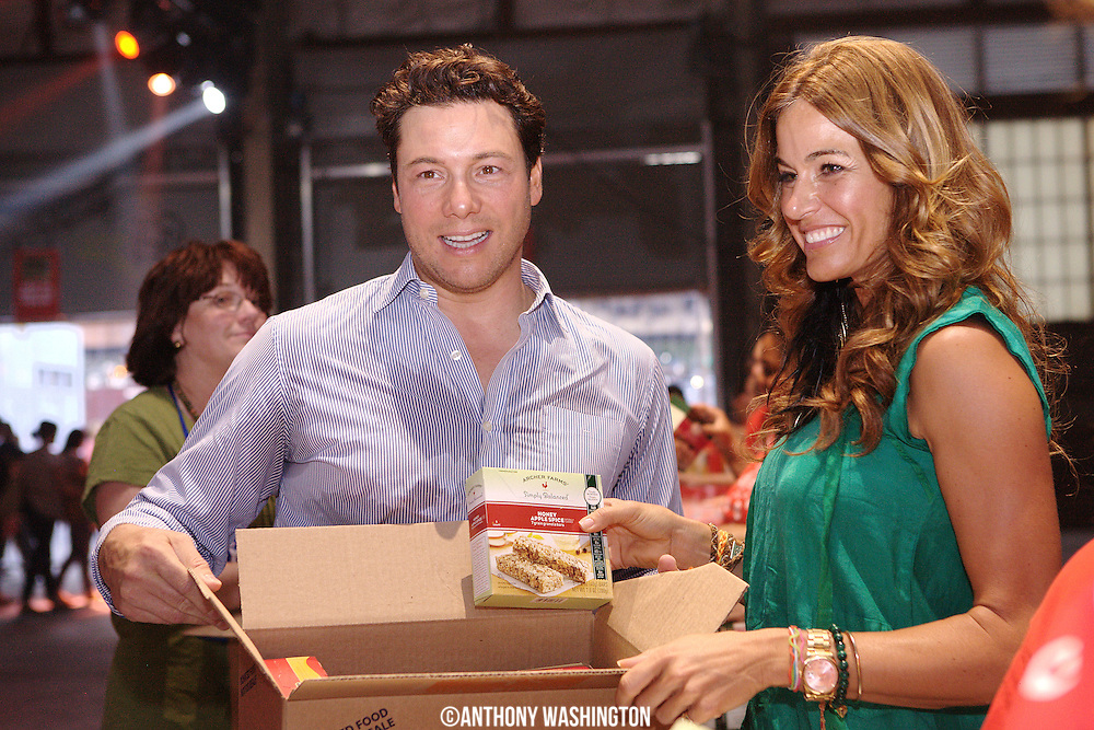 Celebrity chef Rocco DiSpirito & Real Housewives of New York cast member Kelly Bensimon pose for a picture at the Target Party for Good at the National Conference on Volunteering and Service on Tuesday, June 29, 2010 in New York, NY.