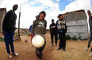 Local kid playing soccer in Rocklands a Township outside of Bloemfontein South Africa on 23 June 2009, during the 2009 Confederations cup in South Africa. Photo:Gerhard Steenkamp/Superimage Media