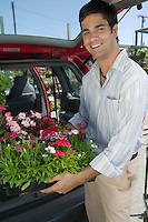 Man Loading Flowers into Van