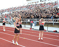 Maddi Ranney, 16, sophomore, of Marion, pumps up the Linn-Mar student section before the start of the game between Cedar Rapids Kennedy and Linn-Mar at Linn-Mar Stadium in Marion on Friday evening, September 2, 2011.