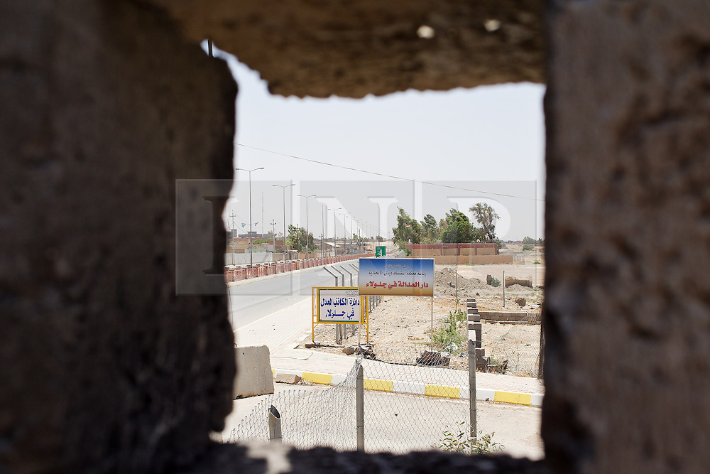 © Licensed to London News Pictures. 30/06/2014. Khanaqin, UK Khanaqin, Iraq. An area of Jalawla in Iraq, controlled by ISIS insurgents, is see through a firing hole at a Kurdish peshmerga base. Counted by Kurds as part of their homeland, fighting in the town of Jalawla now consists of occasional skirmishes and exchanges of fire between snipers and heavy machine guns on both sides.<br /> <br /> The peshmerga, roughly translated as those who fight, is at present engaged in fighting ISIS all along the borders of the relatively safe semi-automatous province of Iraqi-Kurdistan. Though a well organised and experienced fighting force they are currently facing ISIS insurgents armed with superior armament taken from the Iraqi Army after they retreated on several fronts. Photo credit : Matt Cetti-Roberts/LNP