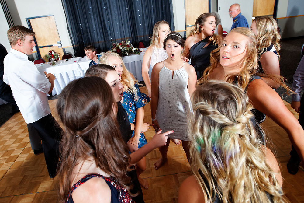 Brittany Burns and Caleb Jolley wedding at the First United Methodist Church and reception at the Montrose Pavilion in Montrose, Colo., Saturday, July 7, 2018.<br /> <br /> Photo by Barton Glasser
