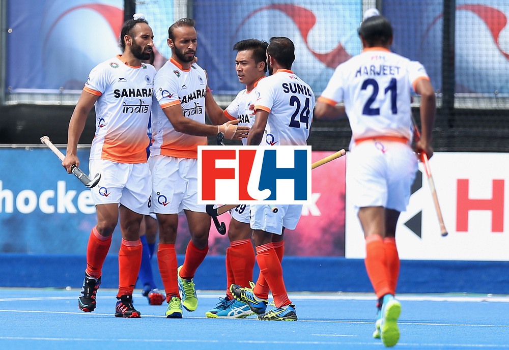 LONDON, ENGLAND - JUNE 15:  India players celebrate as Ramandeep Singh of India scores their first goal during the Pool B match between India and Scotland on day one of Hero Hockey World League Semi-Final at Lee Valley Hockey and Tennis Centreo n June 15, 2017 in London, England.  (Photo by Alex Morton/Getty Images)