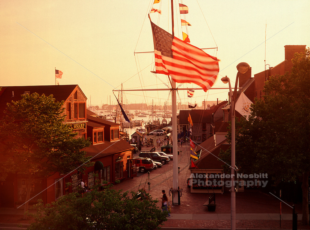 A elevated sunset view looking toward the harbor and Bowen's wharf in Newport RI.