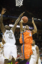 Virginia guard Sean Singletary (44) has a shot blocked by Georgia Tech guard/forward D'Andre Bell (13).  The Virginia Cavaliers fell to the Georgia Tech Yellow Jackets 94-76  in the first round of the 2008 ACC Men's Basketball Tournament at the Charlotte Bobcats Arena in Charlotte, NC on March 13, 2008.