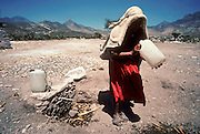 IXMIQUILPAN, HIDALGO, MEXICO: An indigenous  woman walks away from a public well in the desert near the town of Ixmiquilpan, state of Hidalgo, in central Mexico. .PHOTO © JACK KURTZ   WOMEN  ENVIRONMENT   WATER  POVERTY  INDIGENOUS