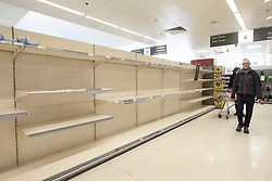 © Licensed to London News Pictures. 21/03/2020. London, UK. Empty shelves of Waitrose supermarket as customers look for food. British Prime Minister Boris Johnson has ordered cafes, bars, restaurants and gyms to close in an attempt to mitigate the spread of coronavirus and COVID-19. Photo credit: Ray Tang/LNP