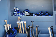 LOS ANGELES, CA - JUNE 17:  Bats, batting gloves, and a batting helmet are stored in dugout bins during batting practice before the Los Angeles Dodgers game against the Colorado Rockies at Dodger Stadium on Tuesday, June 17, 2014 in Los Angeles, California. The Dodgers won the game 4-2. (Photo by Paul Spinelli/MLB Photos via Getty Images)