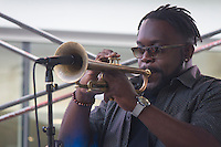 """Makaya McCraven and his group played the second installment of the Harper Court Summer Series Tuesday  evening in Harper Court. <br /> <br /> 1586, 1596 – Trumphet player, Marquis Hill<br /> <br /> Please 'Like' """"Spencer Bibbs Photography"""" on Facebook.<br /> <br /> All rights to this photo are owned by Spencer Bibbs of Spencer Bibbs Photography and may only be used in any way shape or form, whole or in part with written permission by the owner of the photo, Spencer Bibbs.<br /> <br /> For all of your photography needs, please contact Spencer Bibbs at 773-895-4744. I can also be reached in the following ways:<br /> <br /> Website – www.spbdigitalconcepts.photoshelter.com<br /> <br /> Text - Text """"Spencer Bibbs"""" to 72727<br /> <br /> Email – spencerbibbsphotography@yahoo.com"""