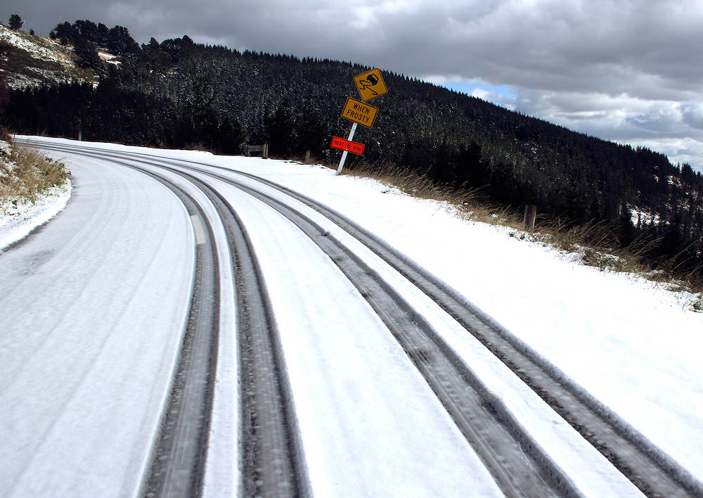 Wheel tracks in the first season's snowfall on the Port Hills, Christchurch, New Zealand, Tuesday, April 14, 2015. Credit:SNPA / Sam Hoeflich