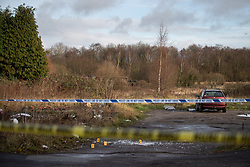 © Licensed to London News Pictures . 29/12/2018 . Wigan , UK . Police forensic markers at the scene where a stretch of Bickershaw Lane in Abram has been taped off . Greater Manchester Police report they have arrested two people on suspicion of attempted murder and for conspiracy to commit attempted murder , respectively , after a 21-year-old man sustained life-threatening injuries yesterday evening (Friday 28th December 2018) . Photo credit : Joel Goodman/LNP