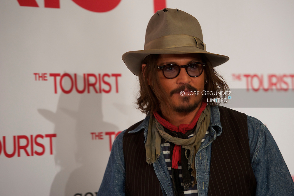 Angelina Jolie and Johnny Depp attend the photocall of The Tourist at Villamagna Hotel in Madrid
