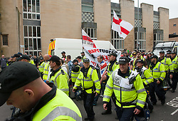 "© Licensed to London News Pictures.04/06/2016. Bristol, UK. Police escort a handful of anti-immigration protesters at protests in Bristol city  centre between the anti-immigration ""South West Infidels"" and anti-fascist campaigners and Bristol Welcomes Refugees. There was  heavy police presence with dogs and horses, but only 18 anti-immigration protesters were escorted by police onto Bristol's College Green which was blocked off to the public by a ring of steel barriers. Photo credit: Simon Chapman/LNP"