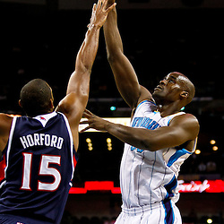December 26, 2010; New Orleans, LA, USA; New Orleans Hornets center Emeka Okafor (50) shoots over Atlanta Hawks center Al Horford (15) during the second quarter at the New Orleans Arena.  Mandatory Credit: Derick E. Hingle
