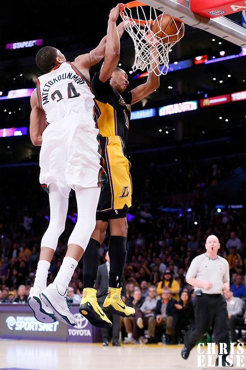 27 February 2015: Los Angeles Lakers forward Wesley Johnson (11) dunks on Milwaukee Bucks forward Giannis Antetokounmpo (34) during the Los Angeles Lakers 101-93 victory over the Milwaukee Bucks, at the Staples Center, Los Angeles, California, USA.