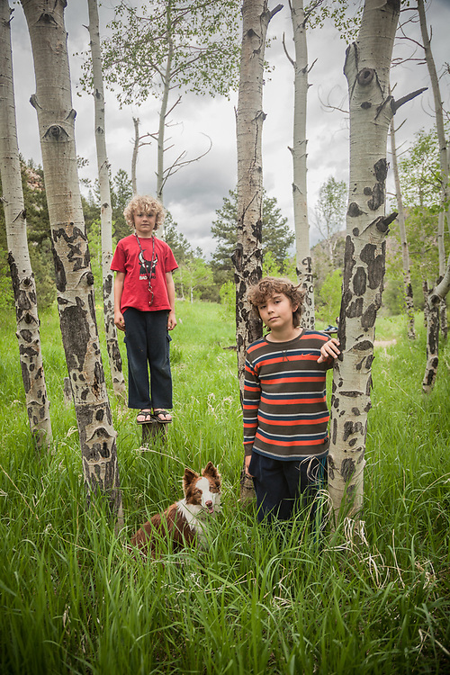 Brothers Owen (8) and Kemper (11) with their dog, Jane, in the mountains above Fort Collins, Colorado  tomrifsmi@comcast.net