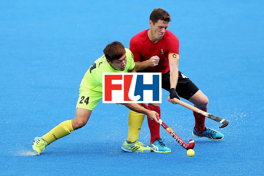 LONDON, ENGLAND - JUNE 24: Tupper Scott of Canada and Wenlong E of China battle for possession during the 5th-8th place match between Canada and China on day eight of the Hero Hockey World League Semi-Final at Lee Valley Hockey and Tennis Centre on June 24, 2017 in London, England.  (Photo by Alex Morton/Getty Images)