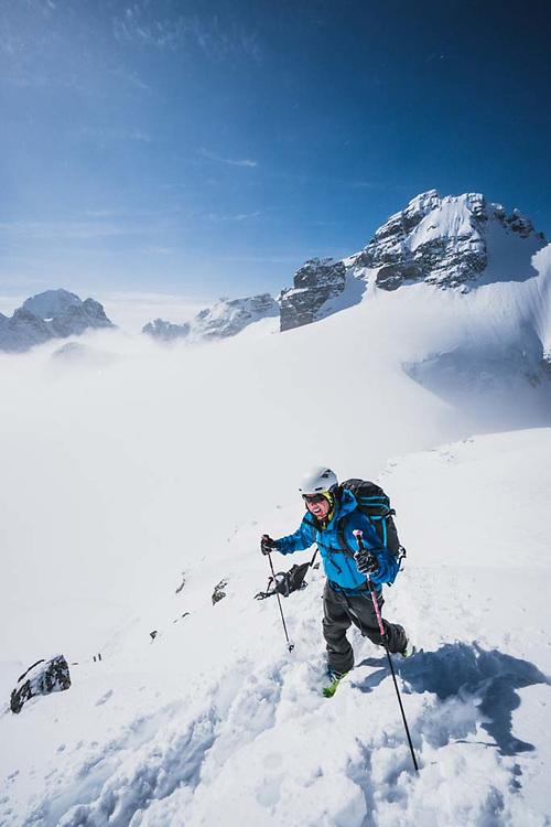 Hank Wissenz near the summit of Solitaire Ski Peak, Howson Range, British Columbia.