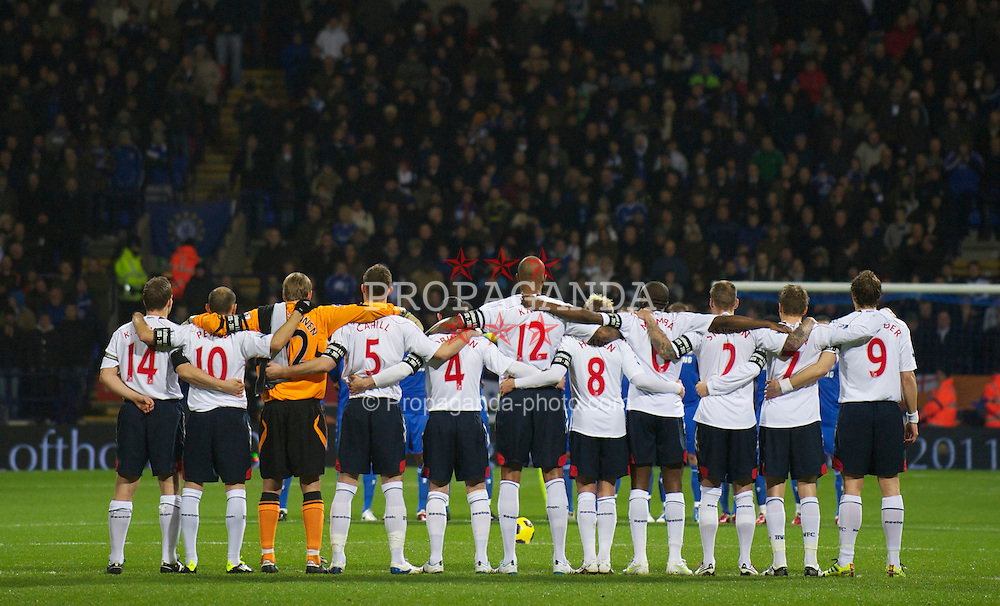 BOLTON, ENGLAND - Monday, January 24, 2011: Bolton Wanderers' players stand for a minute's silence in memory of Nat Lofthouse before the Premiership match against Chelsea at the Reebok Stadium. (Photo by David Rawcliffe/Propaganda)
