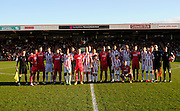 Both teams pose for a team photograph to commemorate the Christmas Day truce of 1914 as part of the #FootballRemembers campaign before the The FA Cup match between Cheltenham Town and Dover Athletic at Whaddon Road, Cheltenham, England on 7 December 2014.