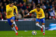 Brazil Liverpool forward Firmino (21) supports Brazil Paris Saint Germain PSG midfielder Neymar (10) on a break  during the International Friendly match between England and Brazil at Wembley Stadium, London, England on 14 November 2017. Photo by Simon Davies.
