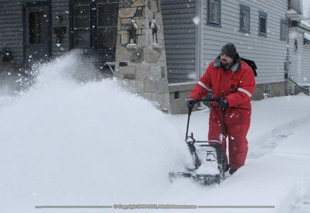 Tom Yahle, of Dayton, ran this snowblower around his Belmont neighborhood, early Tuesday morning, before the snow turned to ice.