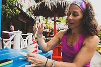 Jacki Arevalo enjoys a Miami Vice daiquiri (pina colada and strawberry) from Twin Brothers Restaurant in Fish Fry, Nassau, Bahamas.