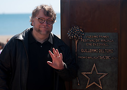 April 14, 2018 - Malaga, Spain - Mexican film director Guillermo del Toro poses next to a monolith in his honour as part of 'Málaga-SUR' award during the 21th Malaga Film Festival, in Malaga. (Credit Image: © Jesus Merida/SOPA Images via ZUMA Wire)