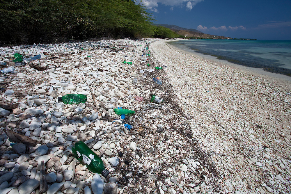 Bottles litter a beach on the south of Ile de La Gonave in Haiti