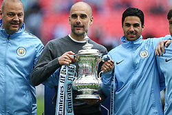 Manchester City manager Pep Guardiola with the trophy - Mandatory by-line: Arron Gent/JMP - 18/05/2019 - FOOTBALL - Wembley Stadium - London, England - Manchester City v Watford - Emirates FA Cup Final