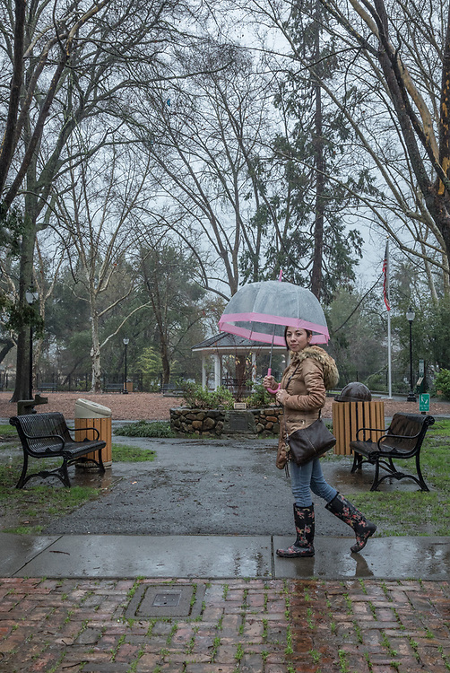 Sales associate Jenny Romano walks past Pioneer Park on Cedar Street on her way home in Calistoga.
