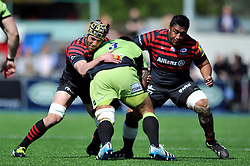 Salesi Ma'afu (Northampton) is tackled by Kelly Brown (Saracens) - Photo mandatory by-line: Patrick Khachfe/JMP - Tel: Mobile: 07966 386802 13/04/2014 - SPORT - RUGBY UNION - Allianz Park, London - Saracens v Northampton Saints - Aviva Premiership.