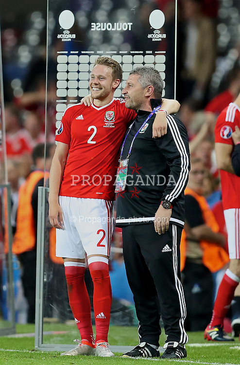 TOULOUSE, FRANCE - Monday, June 20, 2016: Wales' Chris Gunter and assistant manager Osian Roberts celebrate after the 3-0 victory over Russia during the final Group B UEFA Euro 2016 Championship match at Stadium de Toulouse. (Pic by David Rawcliffe/Propaganda)