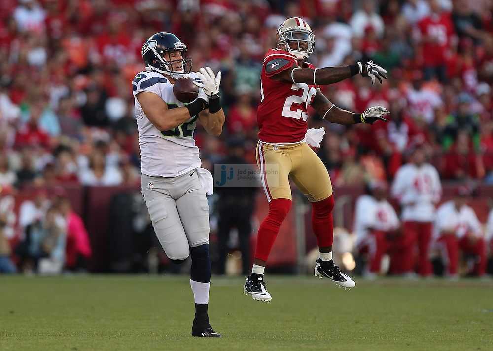 Seattle Seahawks tight end Evan Moore (82) misses a pass as San Francisco 49ers cornerback Chris Culliver (29) defends on Thursday, Oct. 18, 2012 at Candlestick Park in San Francisco. (AP Photo/Jed Jacobsohn)