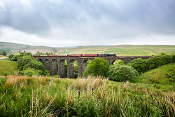 © Licensed to London News Pictures. 04/06/2018. Dentdale UK. LMS Stainer Class 8F Locomotive 48151 pulls the Dalesman over Dent Head viaduct in the Yorkshire Dales today on route from York to Carlisle.. Photo credit: Andrew McCaren/LNP