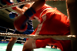 """UK ENGLAND LONDON 2DEC04 - Linklaters lawyer James """"Atomic"""" Burch (blue shirt) trades punches with restaurateur Michael """"The Demon"""" Keenan, during their fight at the London Mariott Hotel, Mayfair. The high-adrenaline contact sport of White Collar Boxing originated in New York 17 years ago and attracts mostly young males from the financial, legal and medical professions.....jre/Photo by Jiri Rezac ....© Jiri Rezac 2004....Contact: +44 (0) 7050 110 417..Mobile:  +44 (0) 7801 337 683..Office:  +44 (0) 20 8968 9635....Email:   jiri@jirirezac.com..Web:    www.jirirezac.com....© All images Jiri Rezac 2004 - All rights reserved."""