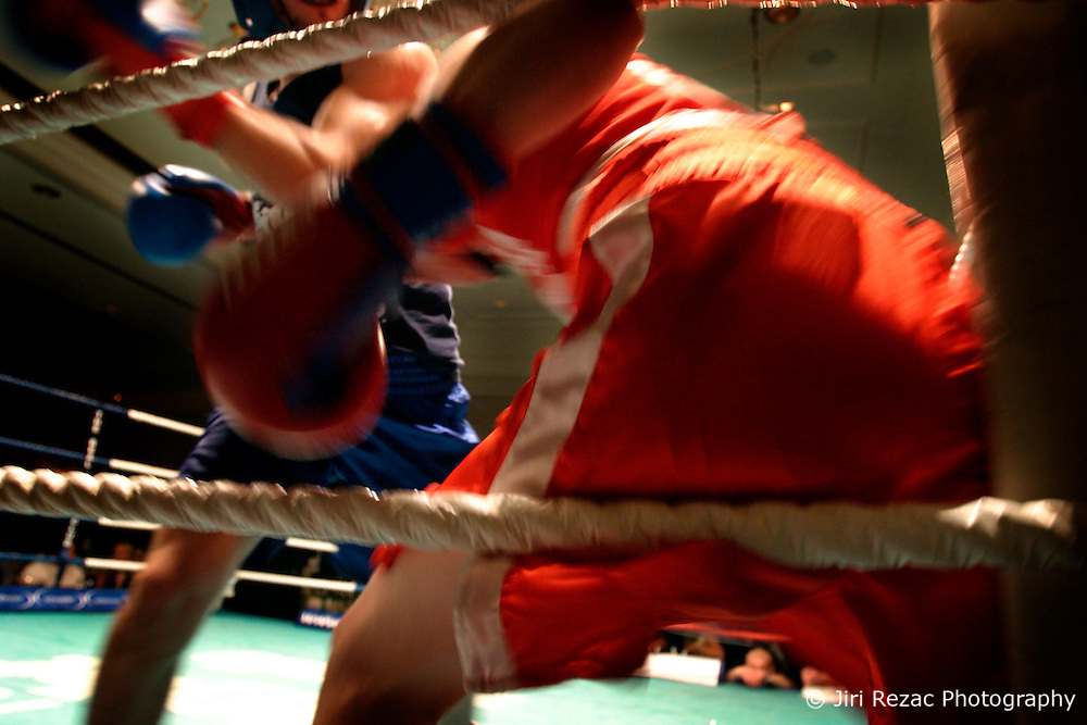 "UK ENGLAND LONDON 2DEC04 - Linklaters lawyer James ""Atomic"" Burch (blue shirt) trades punches with restaurateur Michael ""The Demon"" Keenan, during their fight at the London Mariott Hotel, Mayfair. The high-adrenaline contact sport of White Collar Boxing originated in New York 17 years ago and attracts mostly young males from the financial, legal and medical professions.....jre/Photo by Jiri Rezac ....© Jiri Rezac 2004....Contact: +44 (0) 7050 110 417..Mobile:  +44 (0) 7801 337 683..Office:  +44 (0) 20 8968 9635....Email:   jiri@jirirezac.com..Web:    www.jirirezac.com....© All images Jiri Rezac 2004 - All rights reserved."
