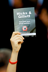 LIVERPOOL, ENGLAND - Saturday, September 12, 2009: Liverpool supporters hold up cards protesting against the club's American owners Tom Hicks and George Gillett organised by fans union Spirit of Shankly during the Premiership match at Anfield. (Photo by David Rawcliffe/Propaganda)