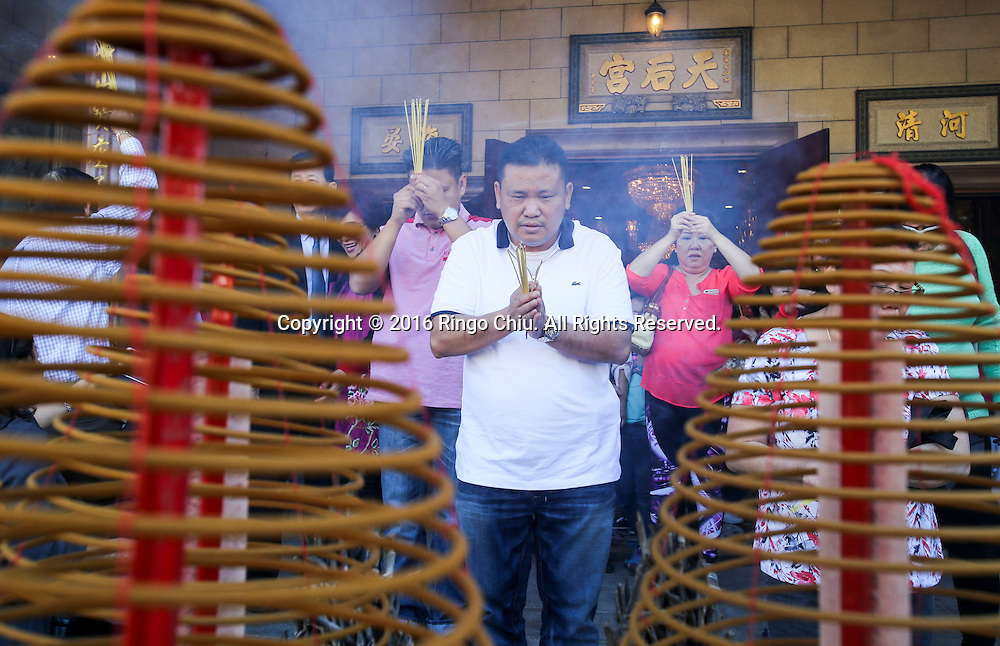 People pray at the Thien Hau temple to celebrate the first day of the Chinese Lunar New Year, the Year of the Monkey, on Monday February 8, 2016, in Los Angeles(Photo by Ringo Chiu/PHOTOFORMULA.com)<br /> <br /> Usage Notes: This content is intended for editorial use only. For other uses, additional clearances may be required.