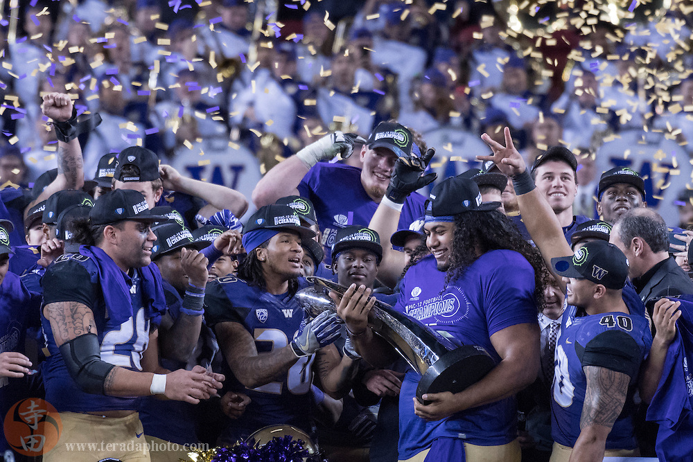 December 2, 2016; Santa Clara, CA, USA; Washington Huskies defensive lineman Vita Vea (50) holds the championship trophy after the Pac-12 championship against the Colorado Buffaloes at Levi's Stadium. The Huskies defeated the Buffaloes 41-10.