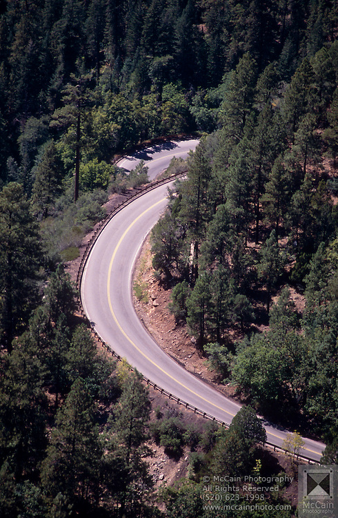 U.S. Highway 89 curving through Coconino National Forest in Oak Creek Canyon, Arizona..Subject photograph(s) are copyright Edward McCain. All rights are reserved except those specifically granted by Edward McCain in writing prior to publication...McCain Photography.211 S 4th Avenue.Tucson, AZ 85701-2103.(520) 623-1998.mobile: (520) 990-0999.fax: (520) 623-1190.http://www.mccainphoto.com.edward@mccainphoto.com